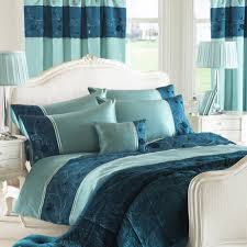 minimalist bedroom with ikea blue teal duvet covers king size 2 drawers white bedside table 2 drawers white bedside table and white carpet flooring