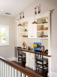 Inspiration for a mid-sized transitional built-in desk dark wood floor and  brown