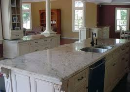 moon white granite countertops and white cabinets