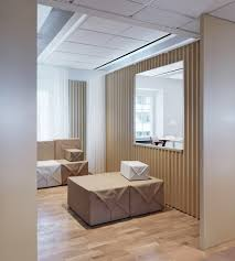 to differentiate spaces within the office the designers chose contrasting materials and shades of green and orange to create small visible islands in cardboard office furniture