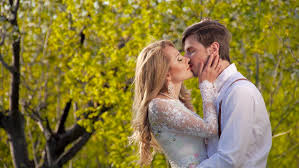 couple in love against the backdrop of greenery caress romance beautiful stylish couple