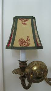 french country chandelier lamp shade in mustard yellow rooster fabric trimmed in a coordinating plaid and