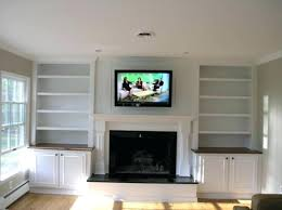 over the fireplace tv cabinet custom built cabinets and wall mount over fireplace electric fireplace television over the fireplace tv cabinet