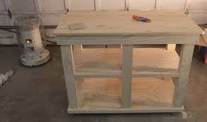 Over the weekend I helped build this kitchen island with a buddy. He took  it over to another friends paint shop to get hit with a few coats of white  (not ...