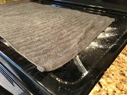 lay a hot towel over sprinkled baking soda to clean your glass cooktop