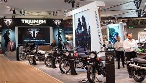 Motorcycle Display Stand Brand New New Logo for Triumph Motorcycles by Wolff Olins 68