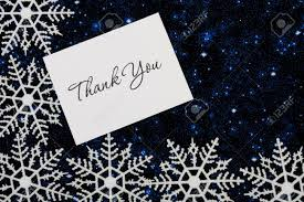Snowflakes With A Thank You Card On A Blue Background Snowflake