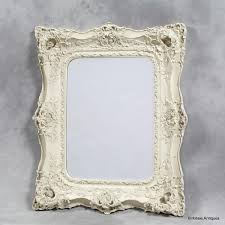 a very large shabby chic mirror cream