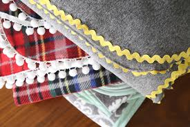 these diy fleece blankets are gorgeous how to make easy trimmed fleece blankets great