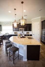 fabulous central island kitchen unit. The Unique Curved Kitchen Island Provides Extra Casual Seating In And Also Gives Large Counter Space, Making Meal Prep Simpler Fabulous Central Unit C