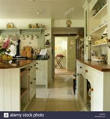 Travertine Kitchen Floors Fitted Dresser And Pale Cream Fitted Units In Country Kitchen With