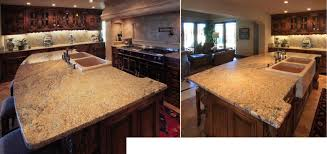 custom residential kitchen features gold coast granite with a massive travertine farmhouse sink and limestone stove