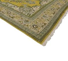 cast off winter doldrums and dial up the cheer with this green and yellow vintage persian
