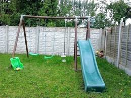 double swing set wooden double swing set with slide and see saw gate double swing set