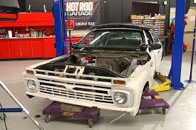 how to swap a cop car frame under an f 100 pickup hot rod network as a gag for their social media followers tony and lucky set the f