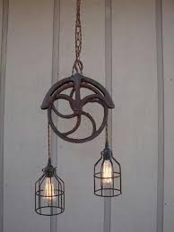 rustic industrial lighting. pulley light fixture more upcycled vintagevintage industrialindustrial designindustrial style lightingedison lightingrustic rustic industrial lighting e