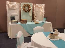 vintage doors with icicle lights and burlap wreath make a cute backdrop behind the cupcake area