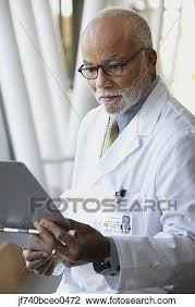Doctor Reading Chart Senior Male African Doctor Reading Chart Stock Image