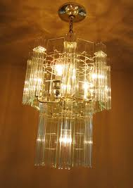 pair 1970s mod glass rod chandeliers