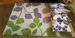 purple and green rug rug cushions and curtains all in cream with purple and green leaf purple and green rug