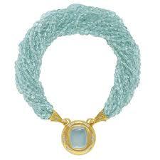 elizabeth gage aquamarine neckalce detachable pendant featuring a fabulous cushion shaped cabochon aquamarine set in a gold and diamond surround