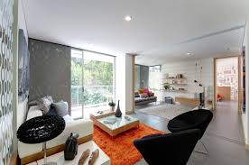 orange rugs for living room black chair and orange rug using grey accent wall for mid