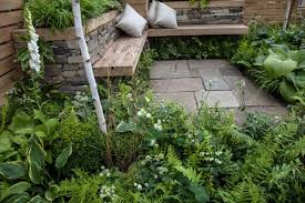 garden with some accent pillows plant some shade loving plants under the bench to surround yourself with greenery
