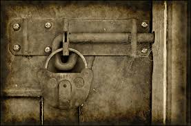 free old grungy lock on door background photo