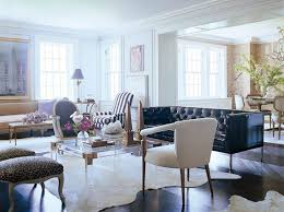 cowhide rug living room sophisticated white cowhide rug with black leather tufted chesterfield sofa for ont cowhide rug