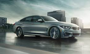 2019 4 series gran coupe driving down a wet city road