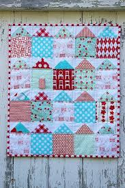 Home Sweet Home: House Quilts & Patterned House Quilt Hanging Against a House Adamdwight.com