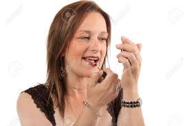 woman holding hand mirror. Woman Holding Hand Mirror Applies Lipgloss To Lips Stock Photo .