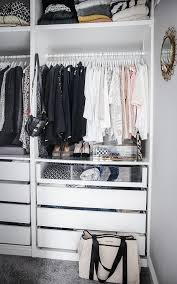 fantastic walk in closet features an ikea pax closet system boasting clothes rails over pull out drawers including see through drawers