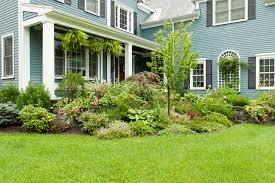 Large planted bed in front yard garden design traditional-landscape
