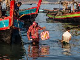 images from a fishing village in burma com fisherman leaving the boat after a long night fishing