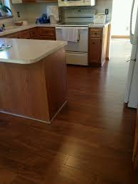 cherry colored laminate floor in kitchen a laminate floor can