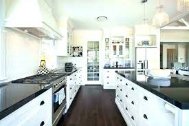 brown granite countertops with white cabinets off white cabinets with granite white cabinet kitchens with granite