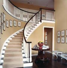 curved wall decor decorating ideas foyer with curved staircase stair case at home furniture on this