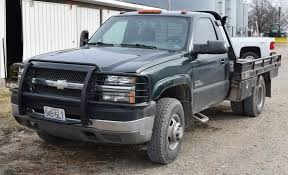 Lot 1077 1997 Chevy 3500 4x4 dually flatbed with hydro bale spike ...
