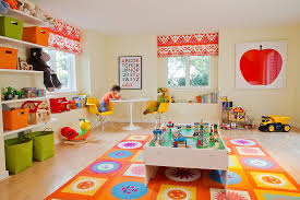 orange rug brings cheerfulness and to the playroom from leighton design group