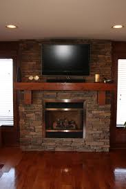 gas fireplace ideas with tv above cabin eterior