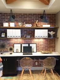 basement office setup 3. gorgeous desk area with exposed brick open shelving industrial sconces and wood beams via basement office setup 3 q