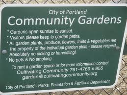 a sign at the north street community garden informs the public on how to register for a community organ