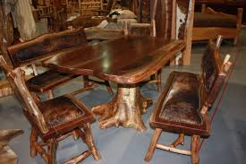 amazing log home dining room furniture set ideas with rustic long wooden table custom handmade using natural tree trunk base pedestal and stunning benches