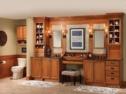 Merillat Kitchen Cabinet Doors Merillat Masterpiecear Tall Entertainment Cabinet With Pocket Doors