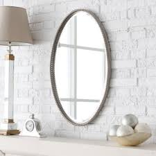 master bathroom mirror ideas oval brown wooden frame wall mirror green accent wall decoration chrome metal
