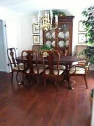 will an 8 x 10 area rug work in the room or is it better to have a broadloom cut to 10 6 x 10 6 for ease of dining chair movement