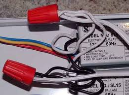 i have found the best cheap flourescent ballast fixture i squeezed that connector to undo the ballast wires and then used regular twist on wire nuts to add the second ballast as shown here