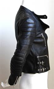 jet black heavy leather moto jacket with heavy silver hardware designed by phoebe philo for her
