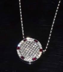 14ct white gold diamond ruby necklace featuring a disc of